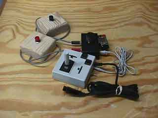 Adapted joystick, switch access box, and switches
